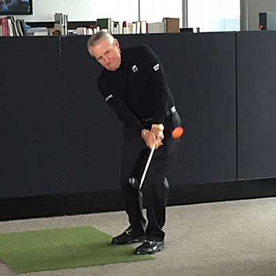 The Black Knight demonstrating his chipping technique at Golf Digest.