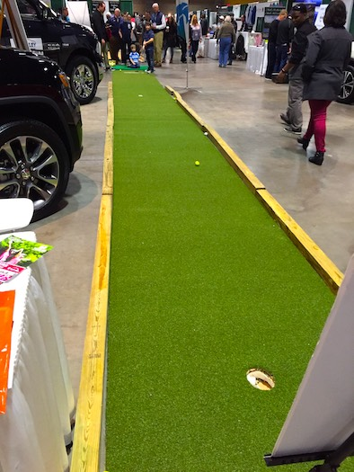 Attendees can try a nearly 50-foot putt.