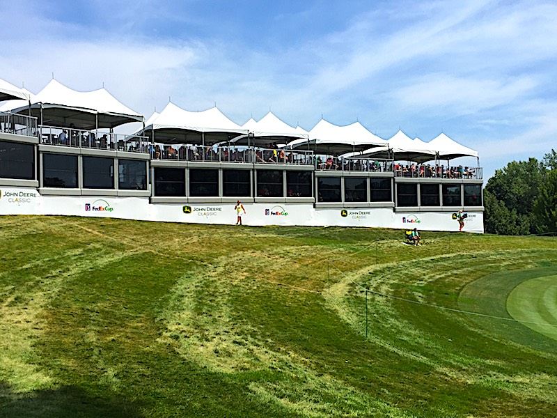 Getting corporate box guests to quiet down for players on 17 green is a near impossibility.