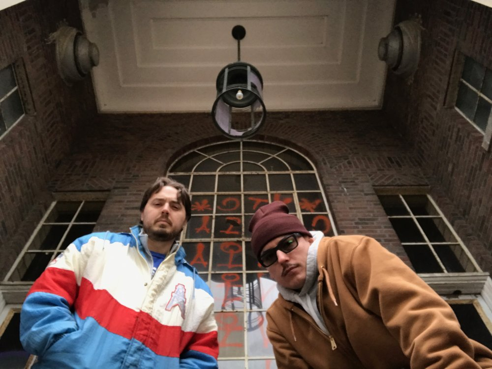 "Watch Joel's fat ass climb thru a window to get to this balcony to take a picture that appears to be the cover to their forthcoming rap album ""Stay in School""."