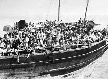 Vietnamese Boat People fleeing the Fall of Saigon 1975 Photo Credit:  History Learning Site