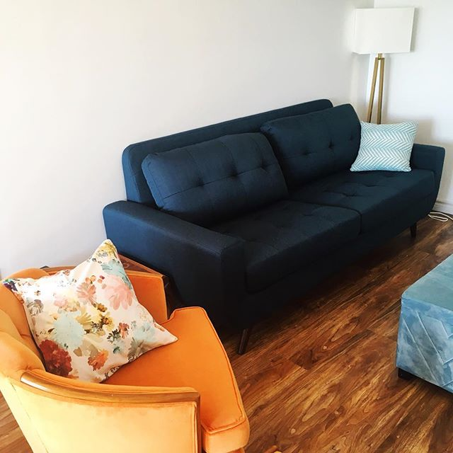 I've got a couch finally and love how it goes with my orange vintage chairs! 😍 Any fabric suggestions for pillows? 😊