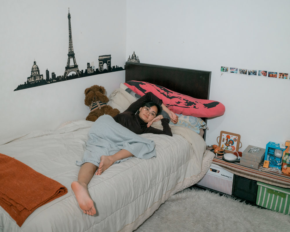 Diandra Elok, my younger sister. Two days before her wedding day laying down on her bed at her own room.