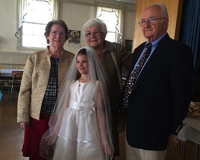 Annie Strysky First Communion Photo with grandmothers 1.jpg