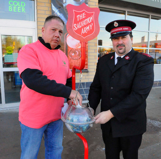 Jeff Ayotte (left) of MariCann, a medical marijuana producer in Norfolk County, presented a cheque for $10,000 to Captain Rick Honcharsky of the Simcoe Salvation Army. The money went to the church's kettle campaign. MariCann opened its operations in Norfolk County in 2013. DANIEL R. PEARCE/SIMCOE REFORMER