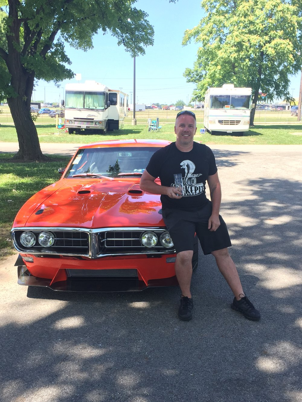 Damon Sturrock after winnig the the Style and Engineering Builder Choice Top 10 Award at the Columbus Goodguys PPG Nationals in 2018 with Project Oculus.