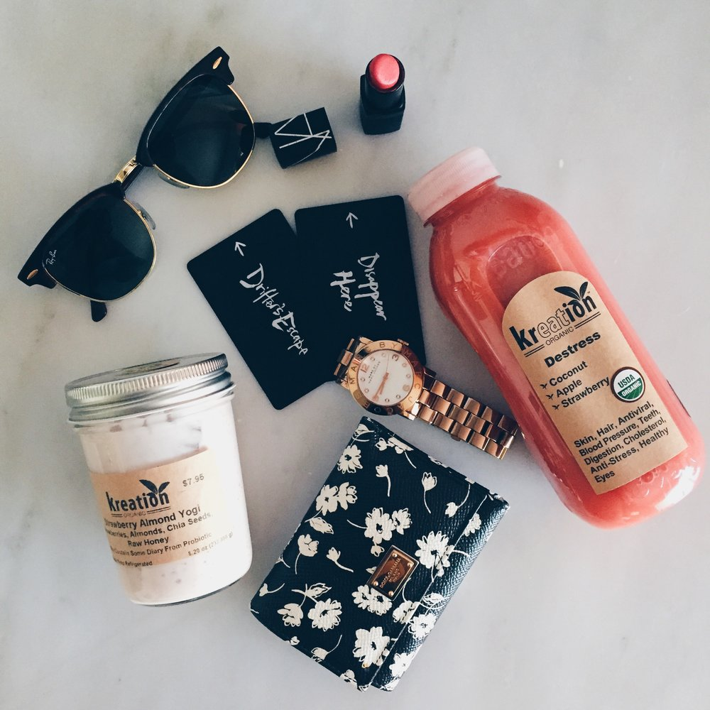 Girl on the go with Dolce&Gabbana, Ray Ban, and a little pick-me-up from Kreation Juice