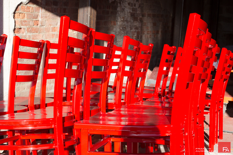 RED CHAIRS   Sparkling red chairs soaking in the sun