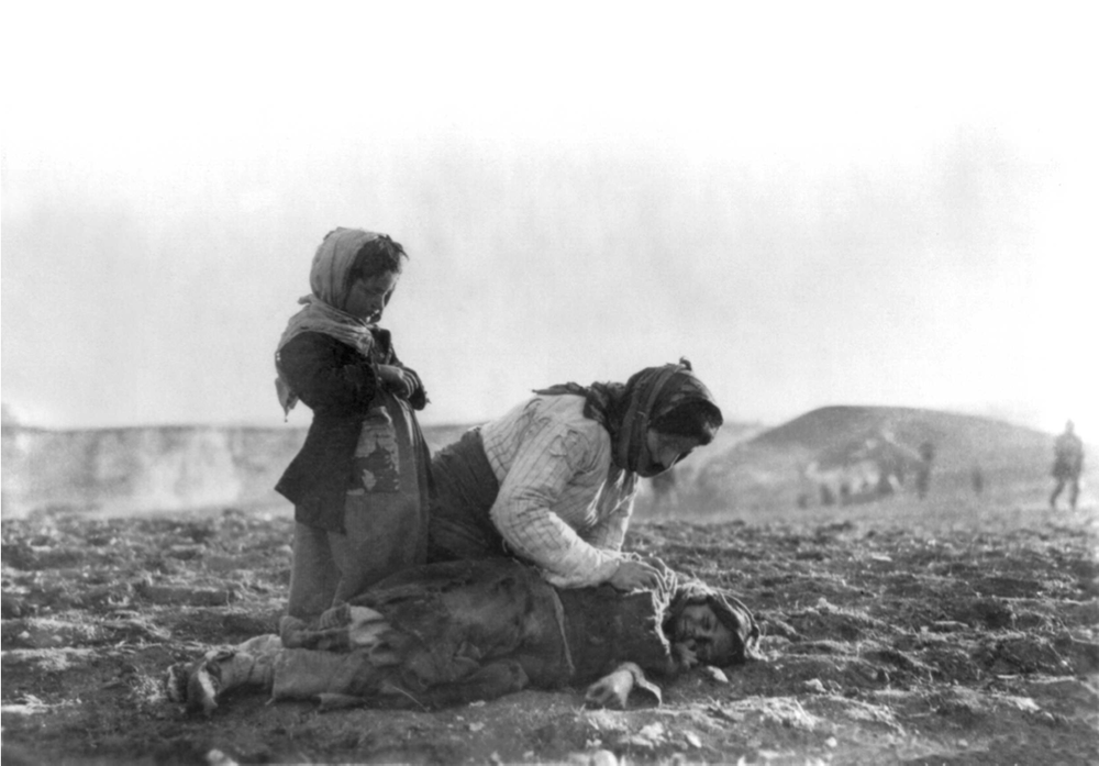 Armenian mother leaning over her dead child