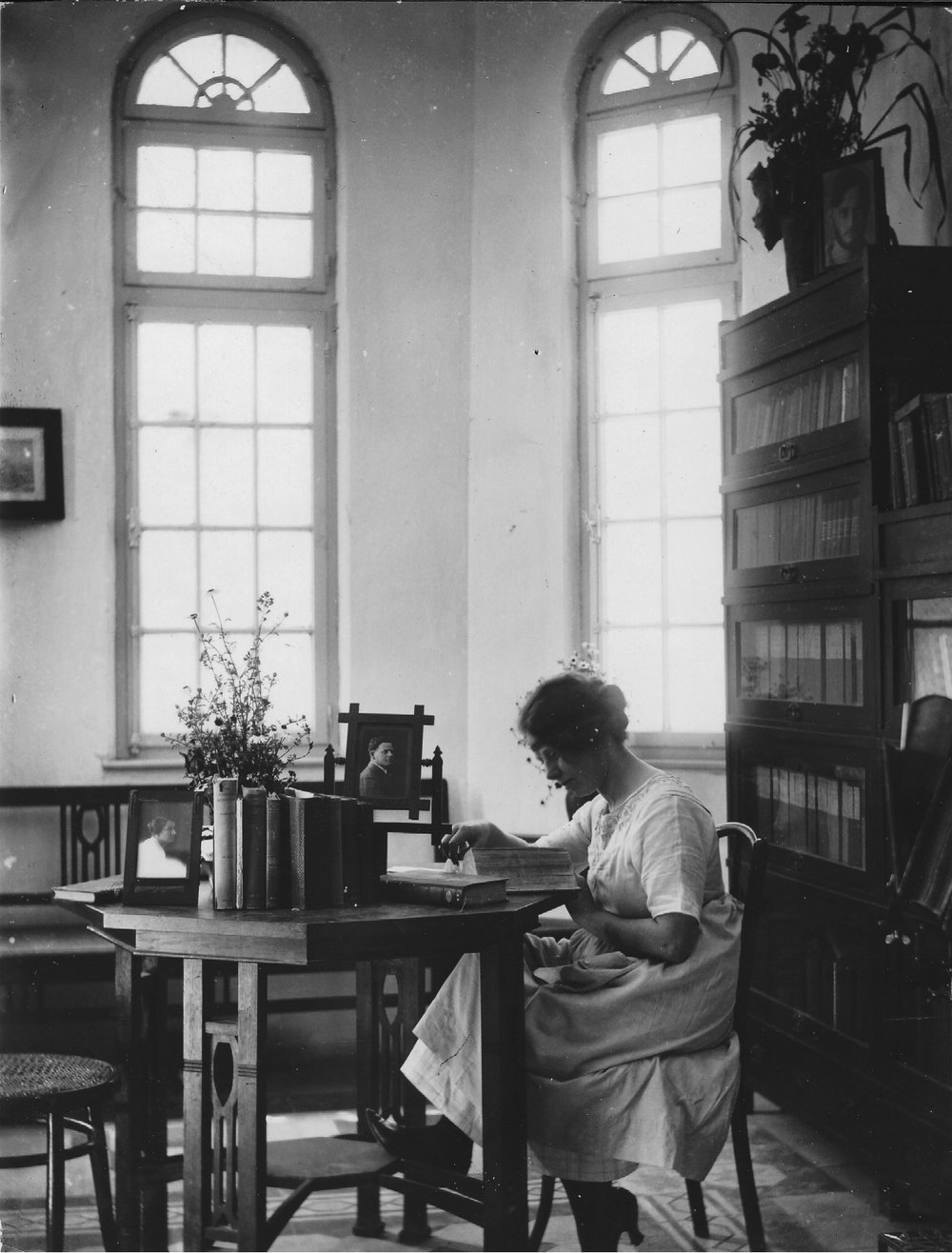 Rivka in Aaron's study after the war
