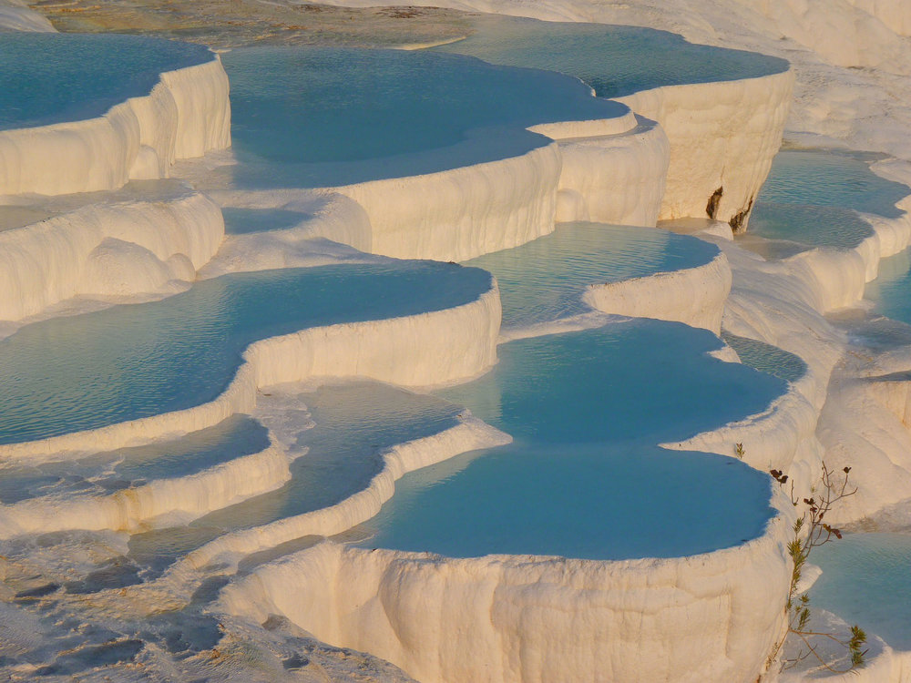 Image of travertines…terraces of carbonate minerals left by flowing water.