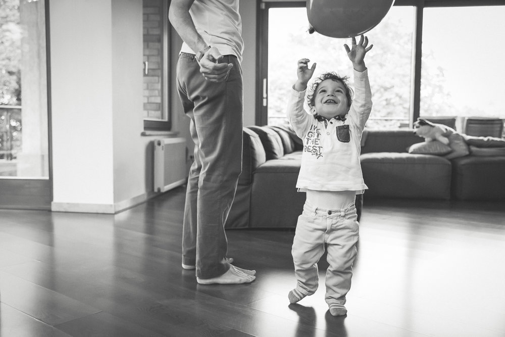 Toddler Chasing Baloon in Living Room.jpg