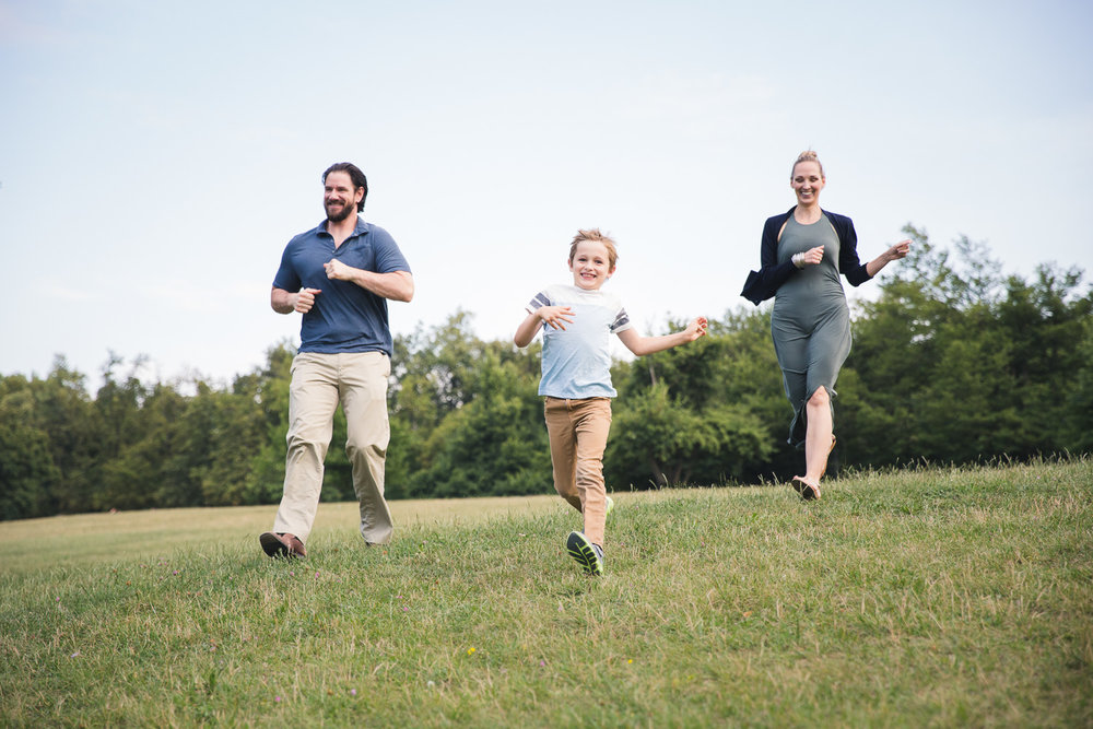 Sandra Ruth Photography Boy and Parents Running in Field.jpg