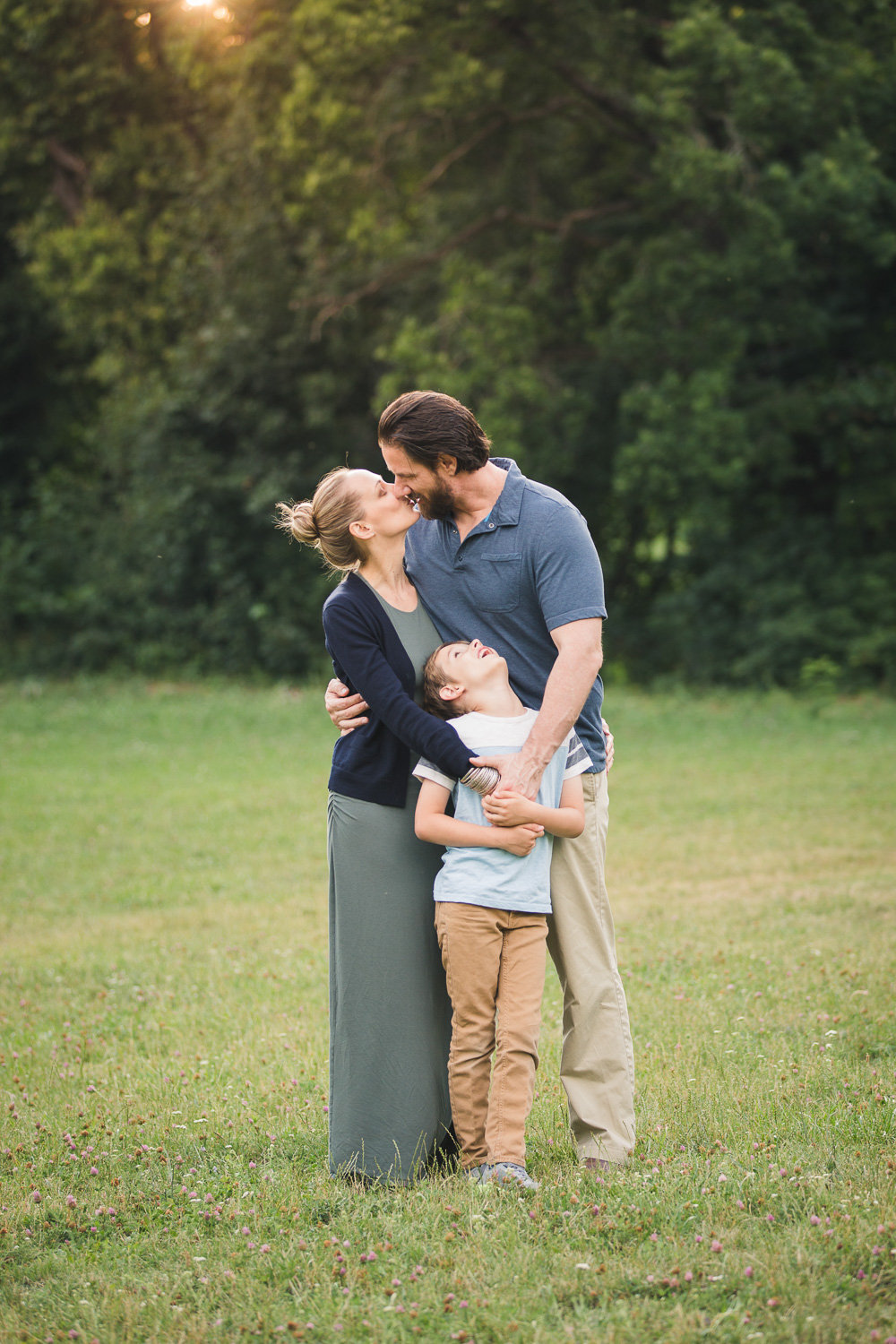 Sandra Ruth Photography Family In Park Kissing.jpg