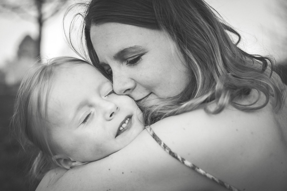 Sandra Ruth Photography Mother snuggling with daughter.jpg