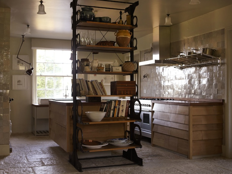 Victorian free standing adjustable shelving (Retrouvius salvaged many parts from the Patent Office on Chancery Lane) and a bespoke kitchen compromising of oak drawer bottoms from the National Scottish Museum. Some of the kitchen walls are covered with in off-white zelliges.