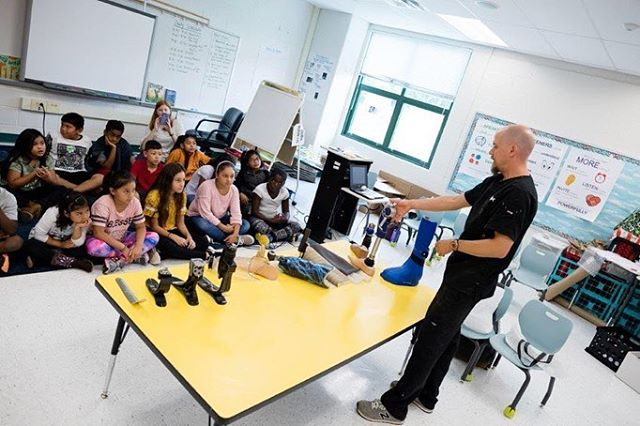 "#Flashbackfriday to when our very own, Ben, who taught these curious kiddos about Prosthetics. 🤙  This past summer, children from around Fairfax County participated in a program called ""Curious Minds"" 🧠where they were able to explore the field of prosthetics, ultimately designing a creative adaptive device for their assigned Paralympian athlete. 🙌 ______ Photos by: Donnie Biggs/FCPS #prosthetics #prosthetics #prostheticfeet #creativity #prosthesis"