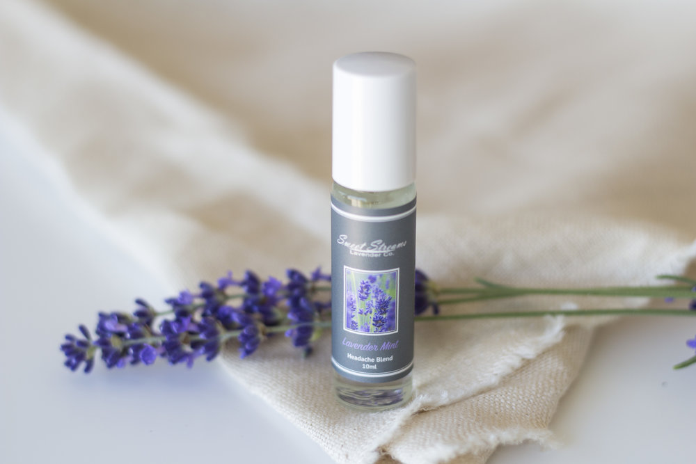 We are so excited to highlight our Lavender Mint Headache Relief Roller for the month of October! This roller has been our best selling product to date and is very popular in easing headaches brought on by stress and anxiety. This approach to natural headache relief helps to ground and relax you – bringing you back to the present moment. The cooling sensation of the peppermint, mixed with the tranquil essence of lavender helps to put your headache at ease. How to use: Apply the headache roller to your temples and rub in gently using your fingertips.  The roller also feels nice and works well on areas of tension, such as the back of the neck and shoulders. Our headache blend is made with jojoba oil, peppermint oil, and Sweet Streams Lavender oil. We also love to make custom headache blends, such as adding eucalyptus oil for sinus headaches. Just e-mail us and we will blend up the desired blend just for you! We love to make our customers feel stress-free and to cater to the needs of their busy lives.  The Sweet Streams Lavender Mint Headache Relief Roller is 10ml and perfect to carry in your purse, briefcase, or gym bag. The small size is travel friendly and TSA approved! This little lifesaver is perfect, especially if you live a life on the go.  As always, find a little time to take a moment for you today. Hugs, Christina
