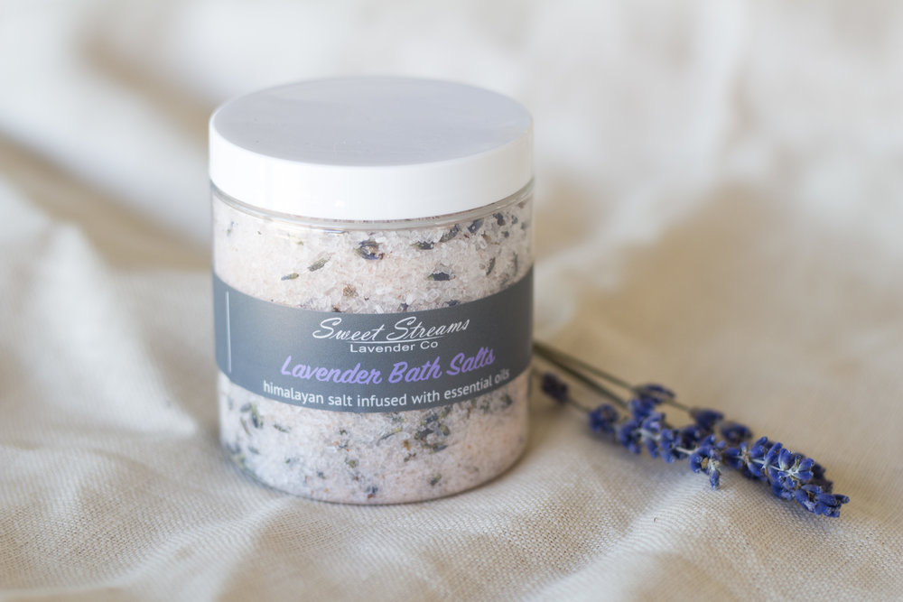 "At Sweet Streams Lavender, we believe it so important to make rest and relaxation a priority. We feel that a small moment of relaxation and ""me time"" helps you to be the best version of yourself at home, at work, and in life.   This month we are so excited to introduce our Lavender Himalayan Bath Salts, infused with lavender essential oils and dried lavender buds. The Lavender Himalayan Bath Salts are a perfect way to unwind after a long day.   Himalayan Salt baths are said to help ease muscle tension and detox the body. The salt mixed with the relaxing properties of our lavender essential oil is the perfect way to carve out a little ""me time"".   How to use: Draw a bath and sprinkle in at least a tablespoon of our Lavender Himalayan Bath Salts to let the stressors of the outside world just melt away.  Relax and enjoy this amazing time for yourself.   Hugs,  Christina"