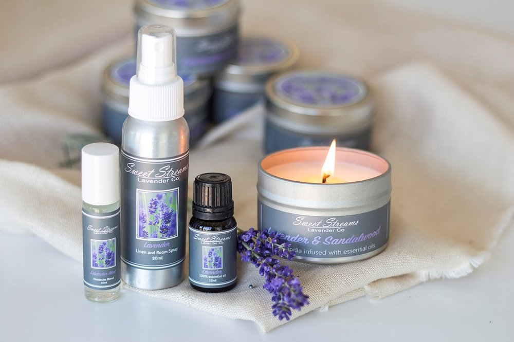 "The season of giving is finally upon us! This is our favorite time of year to show our loved ones how much we care and to treat them to gifts from the heart. What better way to say ""I love you"" or ""you are appreciated"" than with a lavender spa gift set? The  Lavender Essentials  and  Lavender Loves  sets will transport your loved one to a place of tranquil bliss and allow them to forget about the stressors of their day.  In our deluxe and comprehensive  Lavender Essentials  gift set, we include a lavender headache roller, a lavender linen mist, a lavender infused candle, and a lavender essential oil all presented in a lovely grey gift box. For the candle, choose between pure lavender, lavender sandalwood, lavender citrus, or lavender sage. Adorn your loved one with this lavender spa-scented gift set and help all their worries simply melt away.  In our lovingly curated,  Lavender Loves  gift set, enjoy all the products of our deluxe Lavender Essentials without the candle. The  Lavender Loves  set includes a lavender scented linen spray, a lavender headache roller, and a lavender essential oil – also presented in a lovely grey gift box.  Our gift sets are perfect for the loved one in your life that enjoys high quality essential oils, loves the scent of lavender, and prefers holistic remedies and fragrances instead of faux-chemical perfumes. We are local to the Kansas City area and we love when our customers and fans choose local. Thank you for supporting our local business/farm and family.  Our lavender is grown locally in Kansas, and our products are harvested and created on site at our farm. We use sustainable farming practices and are members of the Lavender Growers Association, which means we do not use harsh chemicals or pesticides on our plants.  During the holiday season from November to December, please enjoy  FREE SHIPPING  using the code  HOLIDAYKCFREE  or if you are a Kansas local, visit us at our pop-up shop,  ""Handmade Holidays "" at Town Center, Leawood, KS to shop our products or for free pick-up. We love to cater to you! Address of store: 11555 Ash St. Leawood, KS   Joe and Christina"