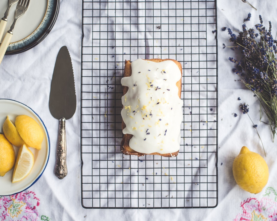 Lemons, lavender, and almond – oh my! This month we are preparing a happy little lemon lavender almond loaf that will shake up your typical winter desserts. This recipe is light and flavorful and is the perfect pairing for a chilly Saturday morning breakfast with coffee. The recipe below makes about three small loaves: Enough to keep one for yourself, one to give to your neighbor, and one to send with your college student back to school for winter finals. In the recipe, we use our own culinary lavender grown right on our farm!   INGREDIENTS  1 stick of softened butter (room temp, unsalted) 2 eggs ½ cup milk (or almond milk) 1 tsp almond extract 2 tbsps of fresh lemon juice                                                                                                                   1 ½ cup flour Pinch of salt 1 tsp baking powder ¼ tsp baking soda 1 cup sugar 1 tbsp culinary lavender 2 tbsps of lemon zest (+ 1 tsp of lemon zest for garnish)   ICING  1 cup Powdered Sugar 2 tablespoons milk (or almond milk)   INSTRUCTIONS  Preheat oven to 350 F 1. In a food processor or blender, pulse together lavender, lemon zest, and sugar until the mixture is finely ground. 2. In separate bowl, mix the flour, salt, baking powder, and baking soda. 3. In another bowl, beat sugar and butter together until creamed (about 5 minutes) 4. In the same bowl as the sugar and butter, add each egg – one at a time. 5. Slowly add the flour mixture to the sugar and butter mixture while mixing. Add in about ½ cup of the flour mixture at a time. 6. Mix the milk and lemon juice together in a measuring cup. Slowly add the mixture to the flour, sugar butter mixture. 7. Mix until all of it is combined. 8. Using a spatula, scoop the mixture into each bread pan. Each pan should be about half full with mixture. 9. Bake for 40-50 minutes or until a knife inserted into the center comes out clean. Enjoy!  Christina