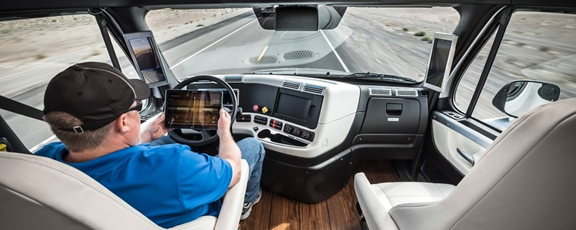 Inside the Freightliner Inspiration truck, a driver could perform additional work-related tasks while monitoring the vehicle in autonomous mode. (Photo: Daimler Trucks)
