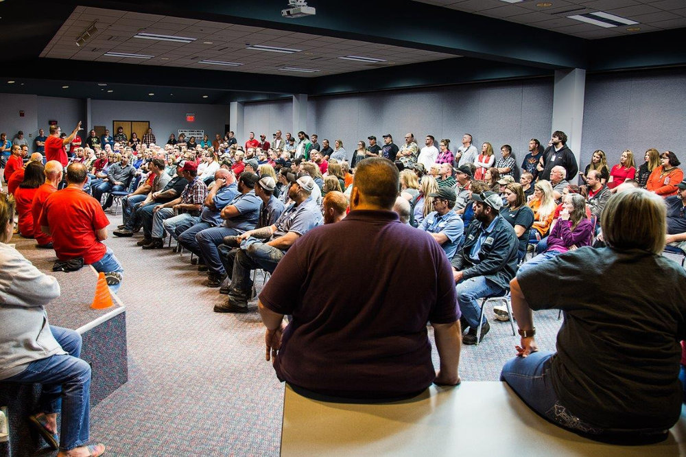 CFI employees in Joplin listen as management addresses changes at the company.