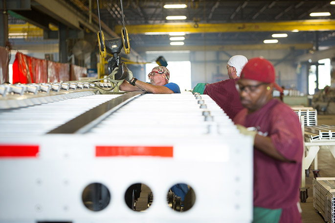 Workers build a trailer at Wabash National's operation in Cadiz, Ky.