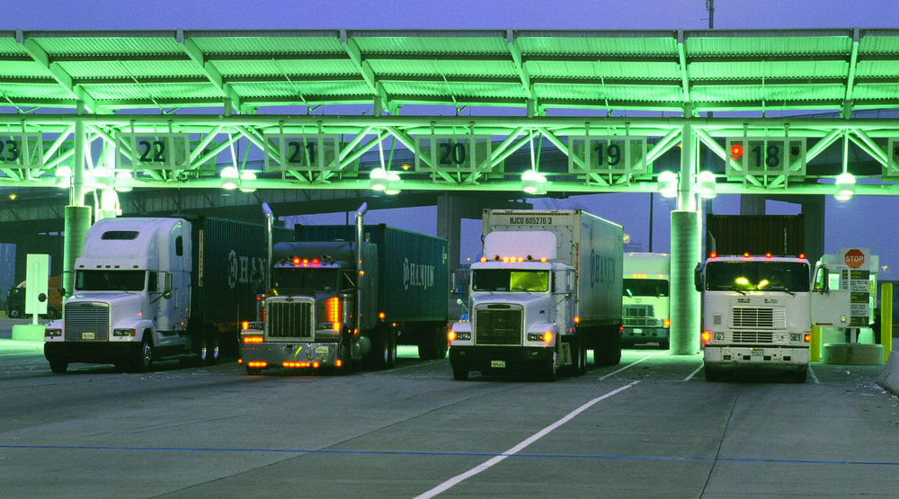 Trucks enter the Port of Long Beach. Three U.S. Senators have sent a letter to retailers demanding answers about the treatment of truck drivers at the ports. ( Photo: Port of Long Beach )
