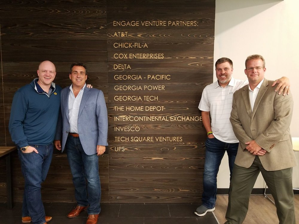 Members of the TransRisk executive team in front of the Engage Venture Partners Corporate Partners wall. Pictured (from left to right): Craig Fuller-CEo;John Bowes- Operations;Arlen Stark-Partnerships; MIchael Vincent- Membership