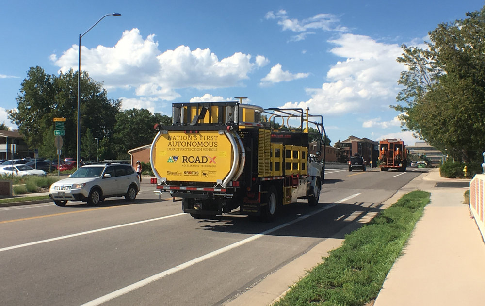 Colorado DOT's Autonomous Impact Protection Vehicle mirrors the movements of a manned vehicle in front of it, moving autonomously and providing a safety barrier for road crews.