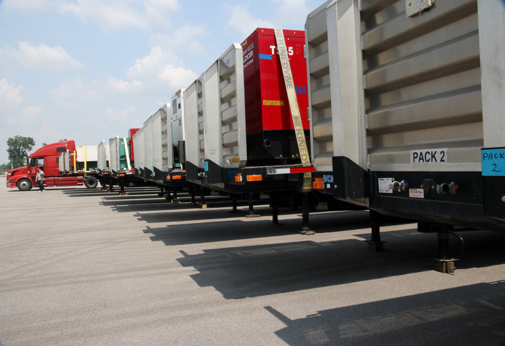Trucks with generators are lined up at a staging site in Carville, LA, loaded with commodities, water, MRES, cots, and other essentials for evacuees impacted by Hurricane Gustav in 2008.