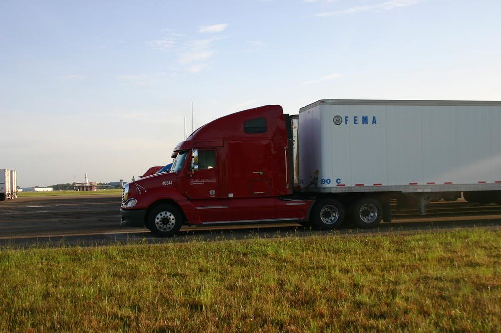 A US Xpress truck, dispatched by Xpress Direct, hauling a FEMA trailer during one of the Florida Four Hurricanes in 2004