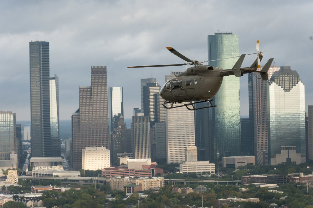 A helicopter flies over Houston after hurricane Harvey.