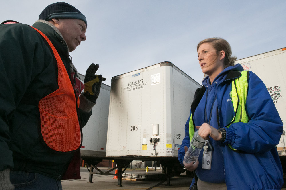 FEMA Corps Team Member Morgan Blake directs tractor trailer traffic at the Farmingdale Airport in 2012. The airport was used as a staging area for Superstorm Sandy relief efforts. ( Photo: Chris Ragazzo/FEMA )