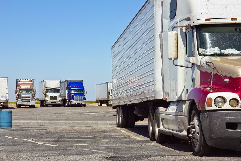Truck drivers using TruckPark's service can reserve a parking spot before arriving at a participating lot, ensuring they have a place to park when their drive time is up. (Photo: Shutterstock)