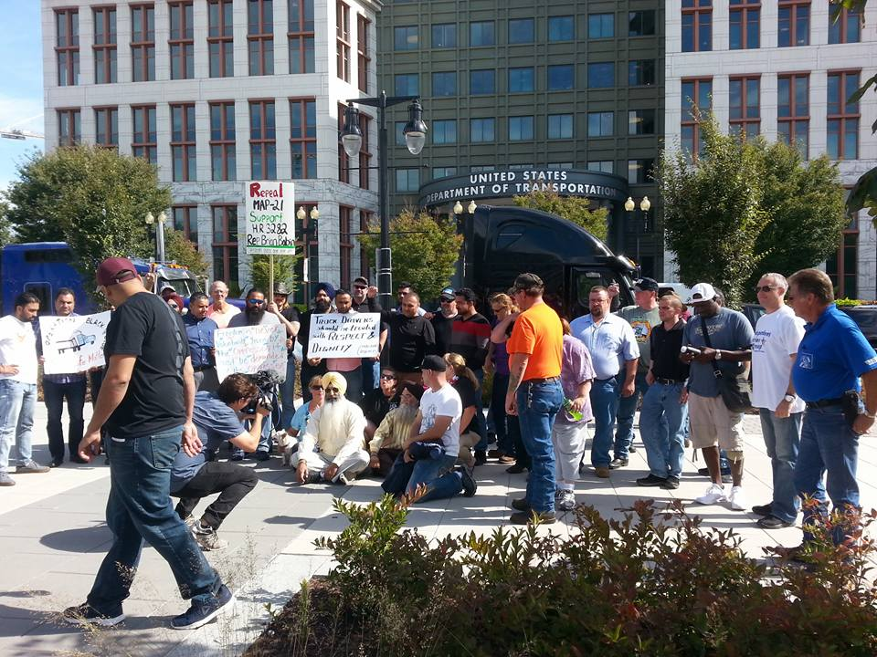 Truck drivers sit outside the Department of Transportation in Washington, DC, to protest regulations such as the ELD rule. ( Photo: Melissa Owens/Operation Black and Blue Facebook page )
