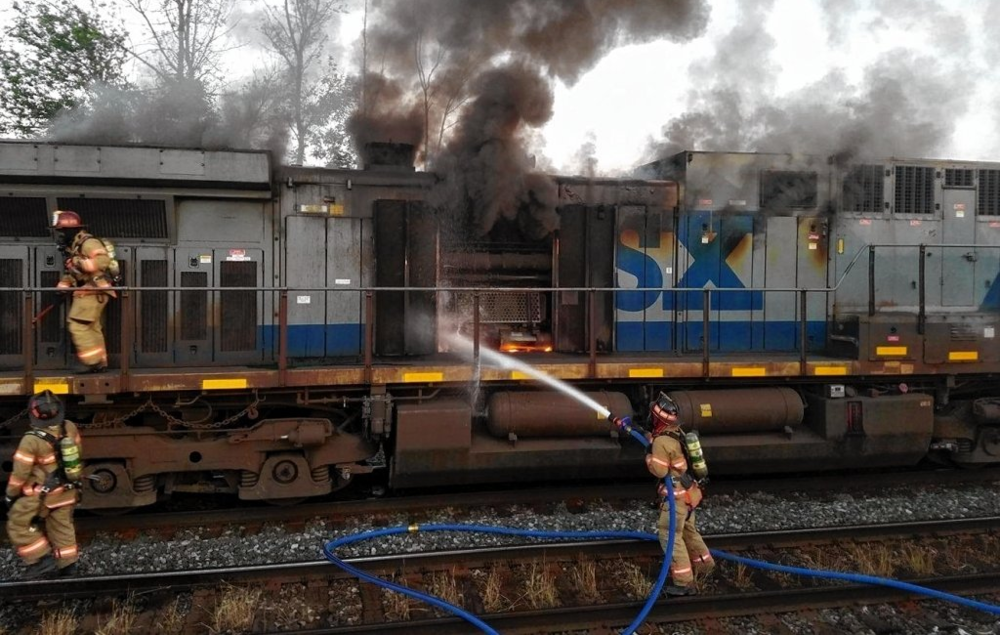 Firefighters try to extinguish a CSX engine fire in East Syracuse, NY, last year.
