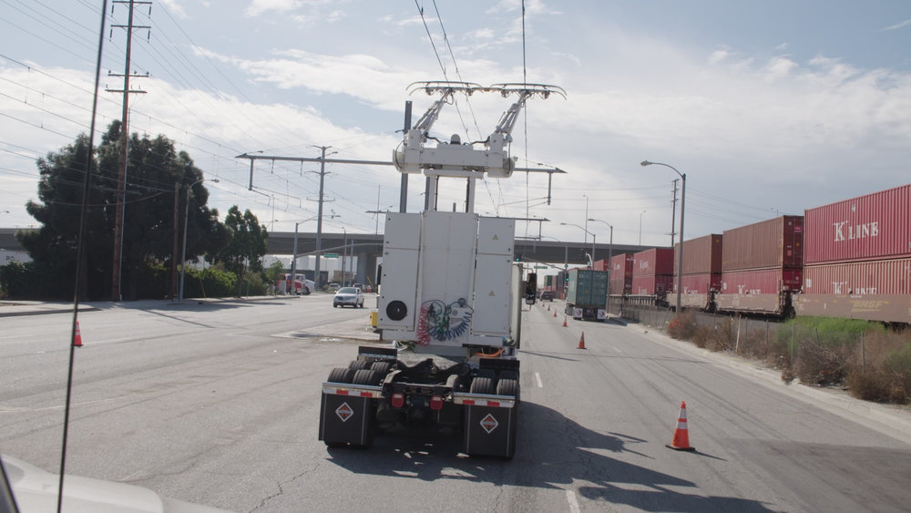 Siemens' eHighway system is being tested between of the Ports of Long Beach and Los Angeles in California. The overhead catenary system supplies electricity to moving trucks.