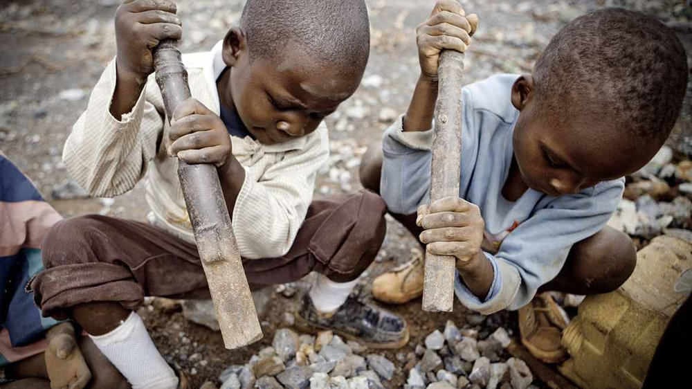 Child laborers identifying stones rich in cobalt ore at a mine in the Democratic Republic of Congo.