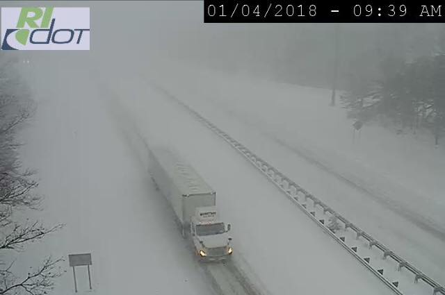 A lone truck travels down I-95 in Rhode Island during the heights of the storm, as seen from a RI DOT traffic camera.