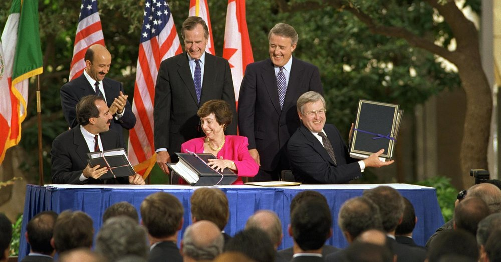 Delegations from Mexico, the United States, and Canada initial the draft of NAFTA in October 1992.