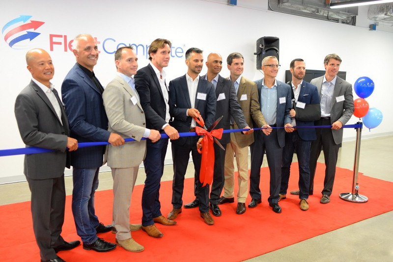 Fleet Complete and Ecofleet executives cut the ribbon following the acquisition of Ecofleet.
