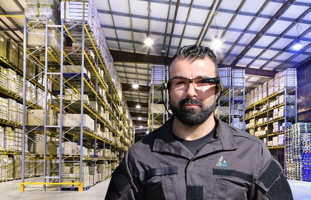 A warehouse worker using an augmented reality wearable device.