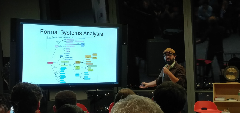 "Michael Zargham, founder and CEO of BlockScience, gives his presentation during the New York Supply Chain Meetup group's discussion on ""Decentralized Systems & Supply Chains."""