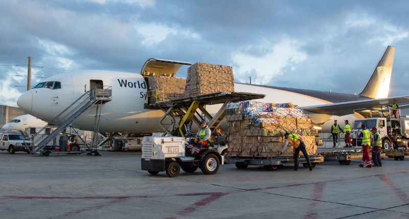 Workers unload flowers from a UPS plane in Miami.