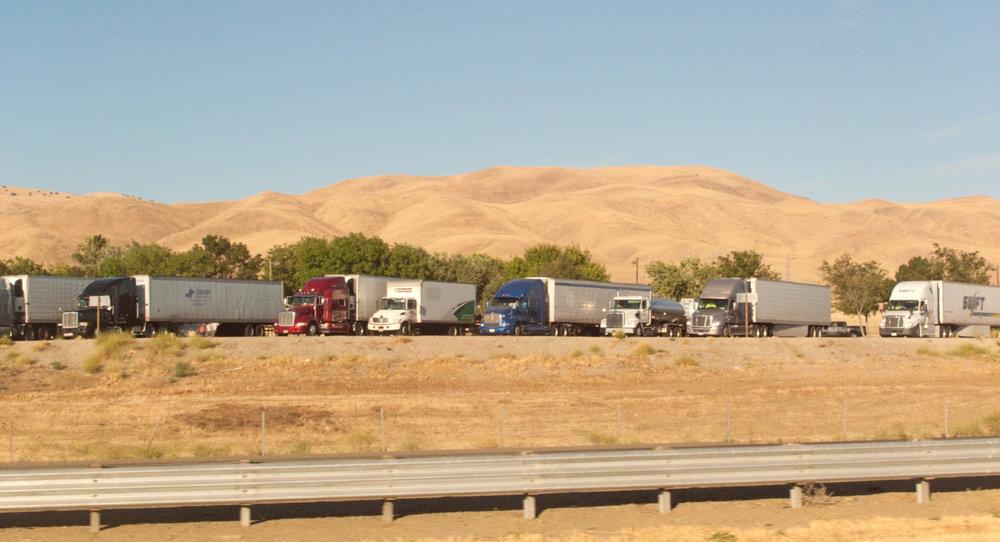 Trucks_parked_along_I-5.jpg