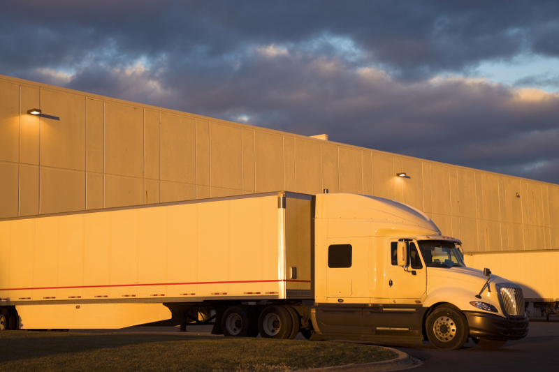 A truck sits at a warehouse waiting to unload. Shippers that work closer with carriers and treat drivers with respect can see lower transportation costs as a result. ( Photo: Shutterstock )