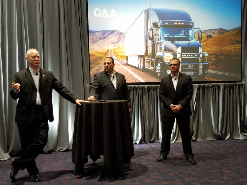 Mack Trucks' Roy Horton, left, Jonathan Randall, center, and Stu Roselli speak to the media during a press briefing on Thursday at the Mid-America Trucking Show.
