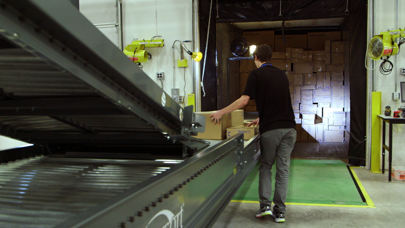 A Walmart worker loads a trailer inside a distribution center. Private fleets can provide significant value to their broader organizations, but they still must compete for business, which is why customer service ranks so high as a top concern. ( Photo: Walmart )